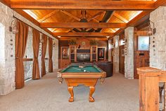 I LOVE this Look!!   Game Room:  Carpeted, Vaulted Wood Ceiling, Antique Heart Pine, Cream Cobblefield Stone Walls, Cove/Recessed Lighting, Lantern, sconces Exposed non-structural wooden trusses, Overlooks LR, Hidden room for whole house wiring origin and A/V equipment.