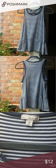 Gap peplum tank top This Gap blue and white striped tank top is perfect for those casual days when you want to look a little more put together. It could also work for a business casual look with a blazer on top. This top is used, but still in good condition. GAP Tops Tank Tops