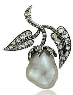 AN ANTIQUE PEARL AND DIAMOND BROOCH. Of floral design, the baroque pearl flowerbud to the old-cut diamond-set leaves and stem, circa 1890.