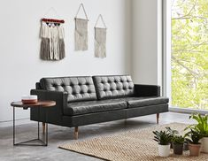 Buy Archer Sofa from Gus Modern. The Archer Sofa's rich, tufted-leather upholstery and brass-finished wood legs help make it a sophisticated statement p. Tufted Leather Sofa, Best Leather Sofa, Leather Chairs, Saddle Leather, Leather Cushions, Sofa Deals, Upholstery Foam, Furniture Collection, Modern Interior Design