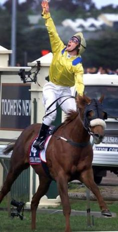 Damien Oliver, riding Media Puzzle wins the 2002 Melbourne Cup only days after his brother jason died in a horse riding accident