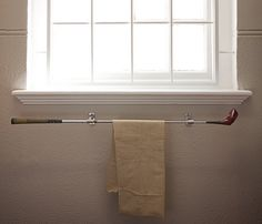 a golf club makes a unique towel rack... Extreme Interior Design: Sports Meet Bathroom Decor from Bathroom Bliss by Rotator Rod