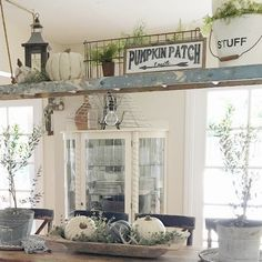 Neutral fall farmhouse decor by Robyn's French Nest. Pumpkin Patch sign from @downgracelane. An old ladder hung over our dining table is so fun to decorate and makes the dining space a feature in our home.