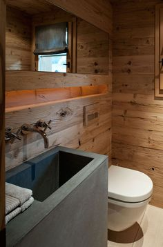 This cozy chalet is located in Gstaad, Switzerland, and was created by the London-based Ardesia Design. The interior mixes crude wood with more modern elements to create a sense of refuge from the outdoor woodland. Photos courtesy of Ardesia Design Chalet Chic, Chalet Modern, Chalet Style, Chalet Design, House Design, Cabin Bathrooms, Rustic Bathrooms, Swiss Chalet, Swiss Alps
