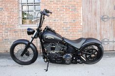 "2006 Harley Davidson Softail 21 X 3.0- Front 18 X 8.5 Rear 60 Spoke 14"" Carlini Evil Apes Custom RSD Solo Seat Vance & Hines Hell Bent Pipes Heartland 250 Wide Tire Conversion Kit Racing Clutch with Burly Easy boy Lite Clutch Integrated Stealth Rear Turn Signals Magnum Black Pearl Brake, Clutch, Throttle & Return Cables Pro 1 Front Fork Assembly Black Bolt Kit with Brass washers 2"" Progressive lowering kit front & rear Custom Paint Job with 22kg Gold Lots of Black Powder Coat & Brass…"