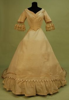 FRONT VIEW: FRENCH TRAINED IVORY SILK BENGALINE WEDDING GOWN, ca 1860. Charles A. Whitaker Auction Co., Auction: Historical Costume Museum Deaccession, 2010.