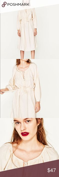 Zara Midi Embroidered Dress Tunic Ecru Midi dress, round neck. Long sleeves with gathered cuffs. Opening with cord details in the front. Belt loops. Tied Belt. Side vent. Embroidered fabric   Color ; Ecru   Composition  Outer shell ~ 91% cotton ~ 9% Linen  Embroidery ~ 100% Polyester Zara Dresses Midi