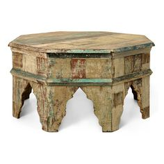 A traditional Moorish accent table collection is made new through the use of reclaimed wood. While the minarets shape of the cut legs and the octagonal shape are quite interesting on their own, our reclaimed wood picks up subtle sanded colors of blue, yellow and red. Each piece is unique and one of a kind.
