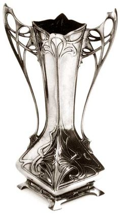 """This elegant Flower Vase is a famous """"Art Nouveau"""" masterpiece.    It was designed by the influential sculptor/designer Albert Mayer for the well known German firm WMF. The Würtembergische MetalwarenFabrik was, around 1900, the world's largest producer and exporter of household metalware, mainly in the JUGENDSTIL style."""