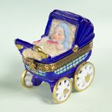 Limoges baby boy in blue buggy box