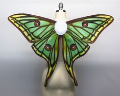 Made to order, ships within 1-2 weeks. These wings are made from cotton fabric, shaped with plastic-coated steel wire. Only the top set of wings are wired. The finished wings measure 35 inches across the widest part. They weigh a little over 3 ounces. They attach to the body with two pieces of elastic (one for each shoulder like a backpack). This listing is only for wings, the wings look good with a black knit dress or leotard.  If the wings get wrinkly, they can be ironed (avoid ironing…