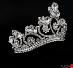 Unique handmade bridal wedding tiara crown inlaid with Swarovski crystals , Asfour crystals and rhinestones , silver wedding tiara crown , royal Vintage Style Bridal Crown    Be the most beautiful Queen bride who you ever dreamed to be...Where the world of shadows meets magic and beauty....    This Royal Vintage -inspired headpiece incorporates a series of various shapes of white clear crystals surrounded by crystal chains.    Measurements:  All Measurements are MODIFIABLE  Approx. 12…