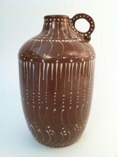 "Bottle.  Deep red stoneware clay, wheel thrown  with white slip trailed design.  7 1/2 "" tall.  (KiteStar Studio - Carolyn Coffey Wallace)"