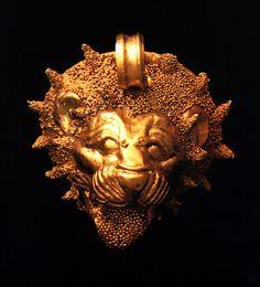 Etruscan exquisite granulation technique gold lion pendant C.550BC Taranto archaeological museum