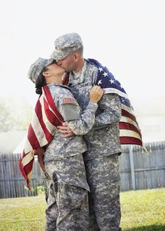 Dual Army Couple, Dual military couple. Army love. American flag. Engagement. Kiss