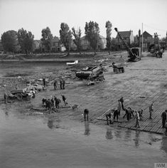 A general view of the beach hardening process at Hardway, Gosport in preparation for the embarkation of the allied invasion fleet. The slipway is being hardened to allow heavy vehicles to easily drive onto LCTs. © IWM (H 38515)