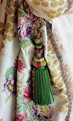Beautiful floral design curtains with coordinating color tassel tie back: