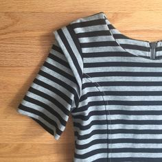 """Striped French Connection Dress NWOT Gray and black striped French Connection dress. Great tailored look! Zips up in the back. Size 8. NWOT - never worn and in """"like new"""" condition. No PP, trades, holds, or lowball offers. Happy poshing! 🎀 French Connection Dresses"""