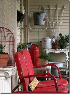 Love the red chairs. I have two of this style and may have to change the color to red. Love this cozy little porch!
