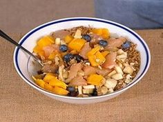 Engine 2 Diet - Big Breakfast Bowl  Combine:  1/4 cup old-fashioned oats  1/4 cup Grape-Nuts or Ezekiel brand equivalent  1/4 cup bite-size shredded wheat  1/4 cup Uncle Sam Cereal  1 tablespoon ground flaxseed meal  2 tablespoons raisins  1/2 handful of walnuts  1 banana, sliced  & 1 kiwi, sliced;  Add 1 grapefruit, peeled & segmented  & 3/4 cup milk substitute of choice