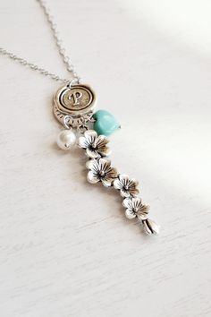 Cascading Flower NecklaceFlowers Charm PendantCherry by KimFong, $21.00