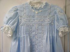 Girls heirloom style dress with lace, tucks, and embroidery.