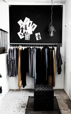 ooh...this photo inspires a clever trick! paint the entrance wall dark if you have no closed storage, so that stuff blends in rather than looking too messy...