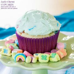 Lucky Charms Cupcakes are made cereal milk and marshmallows in the frosting. From scratch, cake mix, and gluten free cake mix options included.