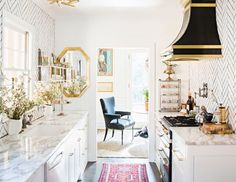 Traditional Kitchen With Bright Rug