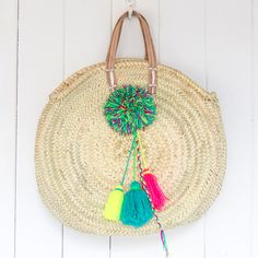 Our market baskets are hand made in Morocco and feature unique neon pom-poms. They make the perfect beach bag and will take you from beach to bar with ease.