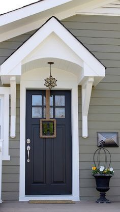 exterior paint color Crownsville Gray HC-106 by Benjamin Moore - Nice door overhang! These colors match our house. We used Storm Cloud Gray 2140-40 and Baby Seal Black 2119-30 for the door with white trim. Love this color combination.