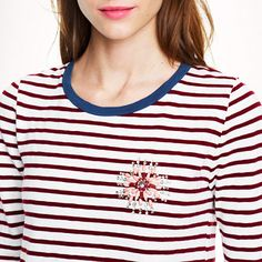 Stripe painter tee with jeweled brooch - J.Crew. This is the type of top that needs to be worn whilst reading a good book.