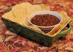 """Black Salsa- this is my take on the Top Secret Recipe guy's clone of Baja Fresh """"Salsa Baja"""". Mine isn't nearly as black as the one at Baja Fresh but it's got a great, deep, smoky flavor. If you roast the tomatoes whole instead of cutting them in half like I did, you will likely get more char on the tomato skins, and a deeper color. If you also add less chopped tomatoes, you'll get a thinner consistency closer to the original. I just like my salsa chunky."""