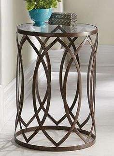With an intriguing interwoven design, the Garner Steel Barrel Accent Table is the perfect addition to any room in your home.