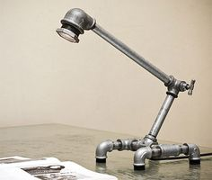 Pipe lamp. Would be nice to try to do this for a DIY weekend project. Also a great gift for engineers.