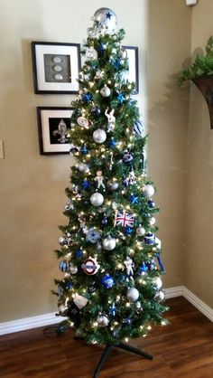 Our Dallas Cowboys Christmas Tree. We added two new ornaments (Union Jack Flag and Mind the Gap) from our trip to London in November to watch the Cowboys.
