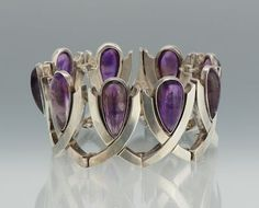 """Antonio Pineda-  Sterling Silver and Amethyst Bracelet                ☆$920.00☆  •Length 7 ½ in.  •970 Sterling Silver bracelet comprised of looped links, each containing a teardrop shape Amethyst cabochon, measuring 22mm x 12mm, with a slide-in clasp and safety chain; •marked with Pineda hallmark in the shape of a crown, and stamped """"ZZ100"""", along with other marks."""
