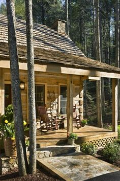 love the look of this house and the porch. Looks so rustic I like the ramp instead of steps