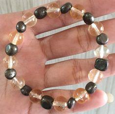#stonebracelet  #bracelet #healingcrystals #fengshui  #charmbracelet #healingstone Healing Stones, Crystal Healing, Pebble Stone, Stone Bracelet, Beaded Bracelets, Charmed, Crystals, Jewelry, Jewlery