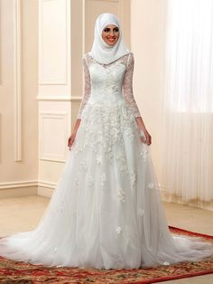 This pretty High Neckline Long Sleeve Lace Muslim Wedding Dress with Hijab has sheer lace sleeves and a modest high neckline and full floor length tulle skirt.  This gown has a back closure, a flattering natural waist  and sweep train, and is available in 5 pretty colours.