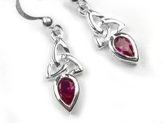 Beautiful sterling silver earrings with a Celtic design and featuring synthetic ruby teardrop faceted stones. Matching the Celtic trinity ruby pendant. Ruby is the birthstone for July and is believed to keep the wearer safe from evil. Synthetic Ruby, Ruby Pendant, Celtic Designs, Sterling Silver Earrings, Birthstones, Swarovski Crystals, Cufflinks, Accessories, Beautiful
