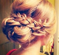 Love this bun rapped by 2 braids looks totally classy