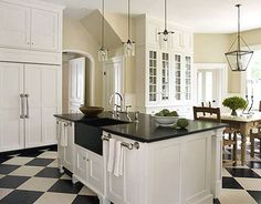 Detail on pantry doors, White cabinets, black granite counters, black and white checkered floor