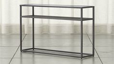 Switch Console Table by Crate & Barrel / $299 / 46W 12D 28.5H / antique pewter finish / designed by Mark Daniel of Slate, Square metal tube, tempered glass top, ash veneer on engineered wood shelf