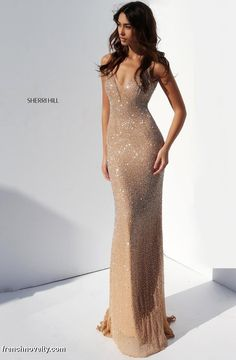 Sherri Hill 50860 is a fully beaded V neck slim evening gown.