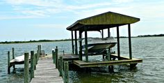 Waterfront HOME FOR SALE - Covered Boat Lift, Dock, Boat Slip, Pool, Cabana, Main Home, plus 5 Rental Cottages in Mary Esther, FL. Contact Platinum Real Estate Associates for more info. Ken Wright 850-582-6442, Dee Sufnar 850-543-7029, Erica Wright 850-420-3883