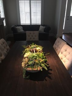 I designed the Lighting and Electrical plan for this client so that the center of the table would be lit and really showcase her table arrangement. The arrangement is are artificial succulents I designed in an antique dough bowl. It is rustic yet formal. Beautiful!