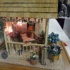 """Miniature Garden Vignettes From the Spring 2014 Seattle Dollhouse Show: Front View of a garden retreat """"Jennett's Shabby Chic Retreat"""" in 1:12 scale, exhibited by Janet M. Oliver at the Spring 2014 Seattle Dollhouse Show."""