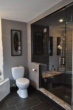 Dark floor, light tub, stone shower floor
