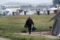 A migrant carries his belongings during an evacuation operation by police forces of a makeshift migrant camp at the border at the Greek-Macedonian border near the village of Idomeni, on May 24, 2016. In an operation which began shortly after sunrise on May 24, hundreds of Greek police began evacuating the sprawling camp which is currently home to 8,400 refugees and migrants, among them many families with children, an AFP correspondent said. At its height, there were more than 12,000 people…